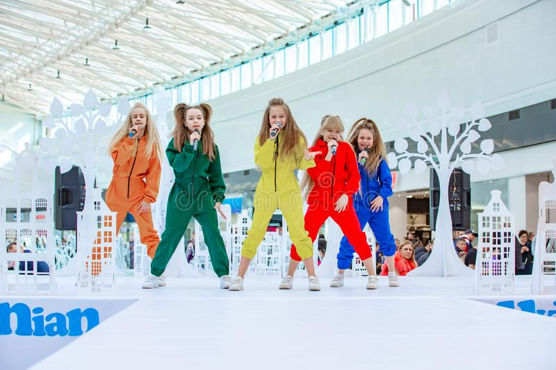Kyiv, Ukraine March 03.2019. UKFW. Ukrainian Kids Fashion Day. A group of little girls singing or performing on stage stock images