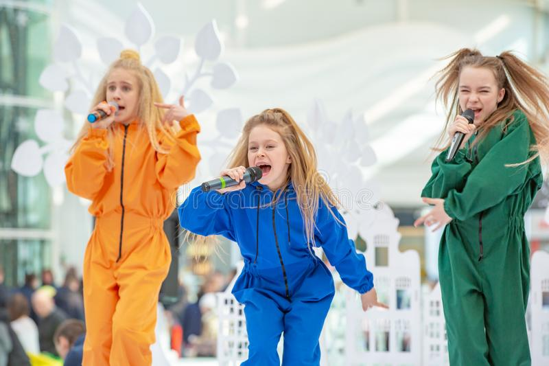 Kyiv, Ukraine March 03.2019. UKFW. Ukrainian Kids Fashion Day. A group of little girls singing or performing on stage royalty free stock images