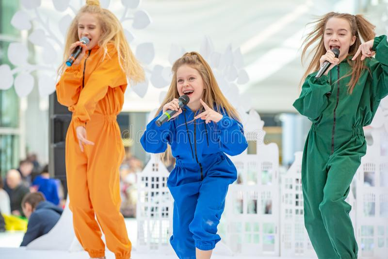 Kyiv, Ukraine March 03.2019. UKFW. Ukrainian Kids Fashion Day. A group of little girls singing or performing on stage royalty free stock photography
