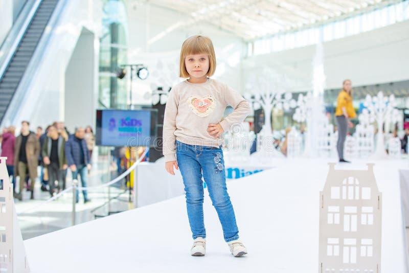Kyiv, Ukraine March 03.2019. UKFW. Ukrainian Kids Fashion Day. Little blonde girl wearing at casual style posing on the podium stock images