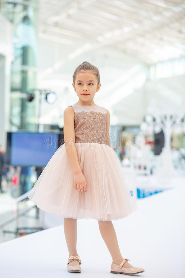 Kyiv, Ukraine March 03.2019. UKFW. Ukrainian Kids Fashion Day. Little girl model weared at pastel dress posing at the podium stock photography