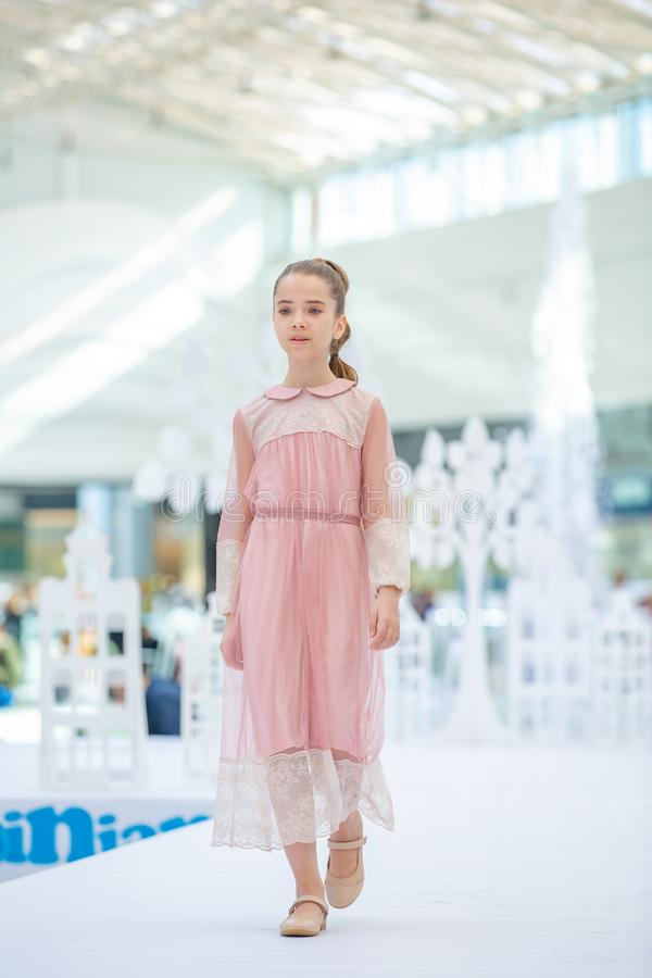 Kyiv, Ukraine March 03.2019. UKFW. Ukrainian Kids Fashion Day. Little girl wearing at pastel dress stock photos