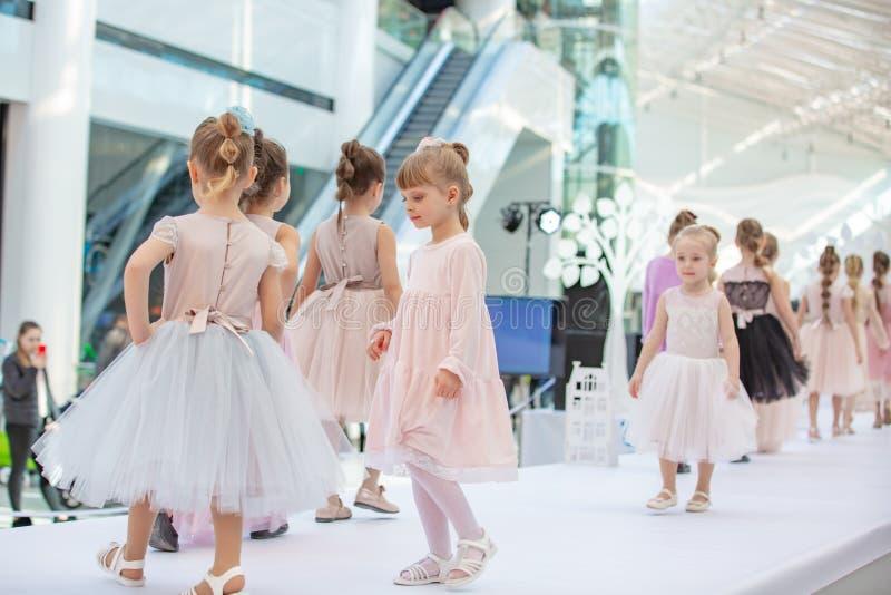 Kyiv, Ukraine March 03.2019. UKFW. Ukrainian Kids Fashion Day. little model girls defile on the podium at the fashion show stock image