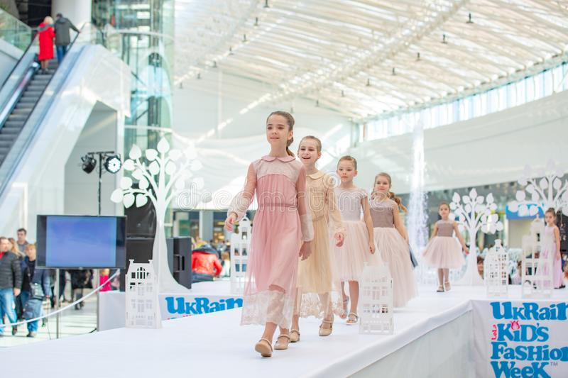 Kyiv, Ukraine March 03.2019. UKFW. Ukrainian Kids Fashion Day. little model girls defile on the podium at the fashion show stock image