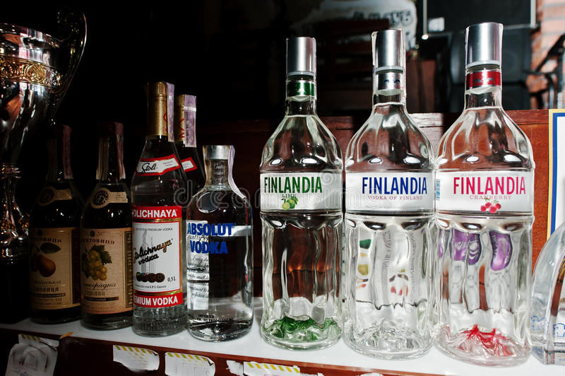 KYIV, UKRAINE - MARCH 25, 2016: Various alcoholic beverages bott. Les in the bar. Finlandia Finland vodka at center stock photography
