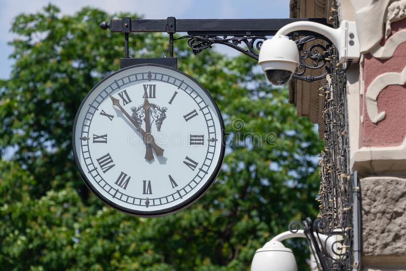 Clock on the facade of the National Bank in Kyiv royalty free stock photo