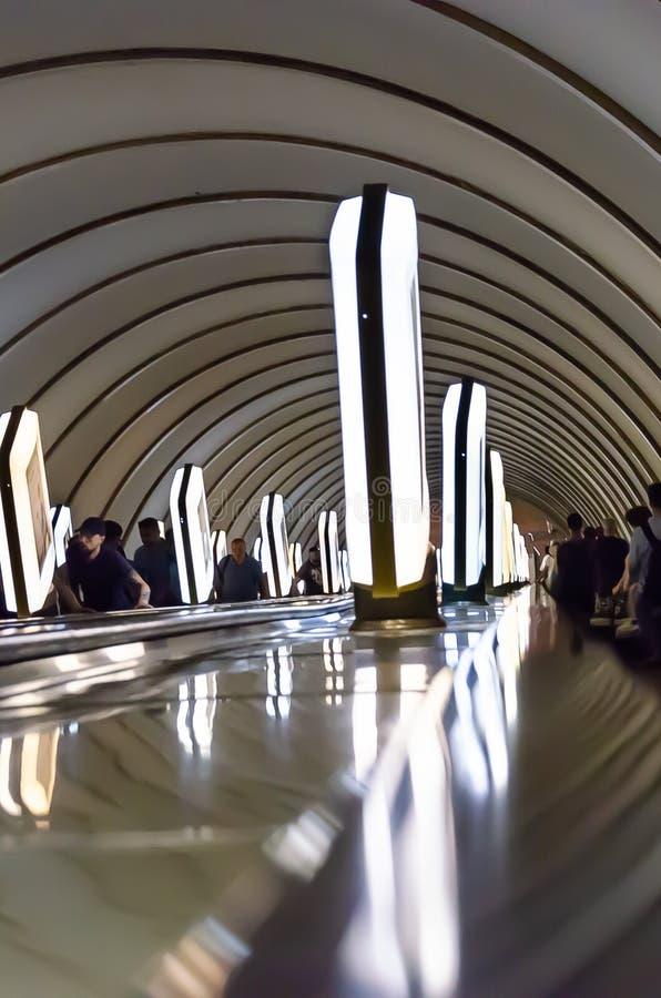 Kyiv, Ukraine - May 31, 2019. Kyiv Metro. Metro station Dorogozhychi. Figures of passengers on escalator and citylights royalty free stock photos