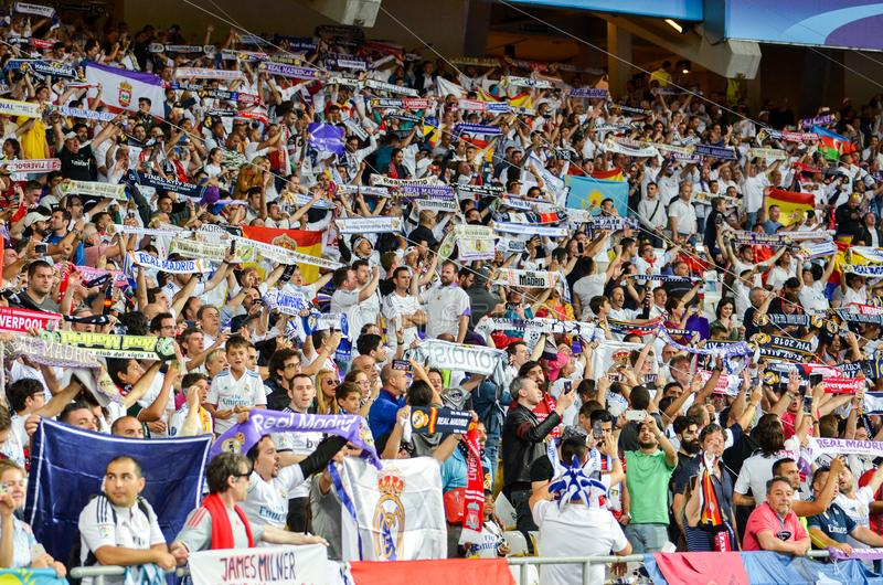 KYIV, UKRAINE - MAY 26, 2018: Real Madrid fans at the stadium support their team before the 2018 UEFA Champions League final. Match between Real Madrid and royalty free stock images