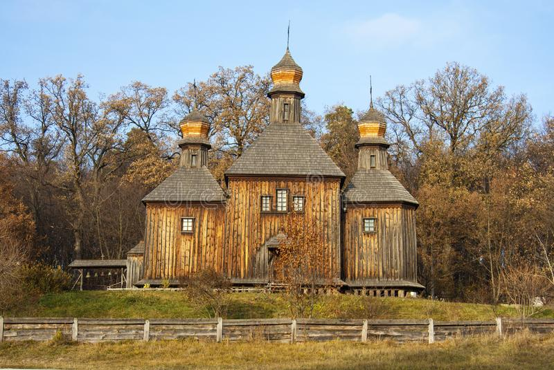 Ancient wooden church and autumn landscape in the Ukrainian national museum open air Pirogovo. Kyiv, Ukraine royalty free stock photo
