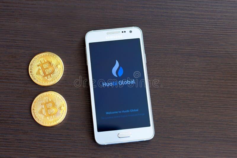 Kyiv, Ukraine - NOVEMBER - 26, 2018: Huobi Global mobile app running on smartphone. Huobi - one of the largest cryptocurrency royalty free stock photos