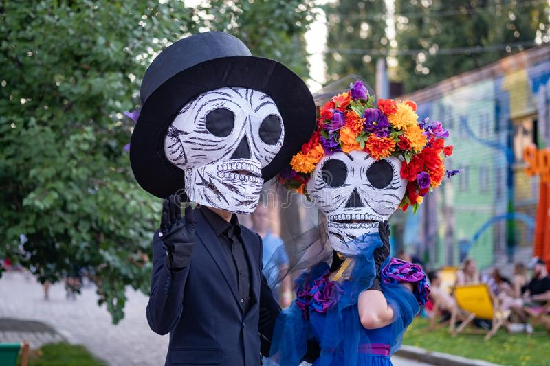 Kyiv, Ukraine, Santa Muerte Carnival, 20.07.2019. Dia de los Muertos, Day of the Dead. halloween. Man and woman. Participants of the in death masks. paper skull stock photos