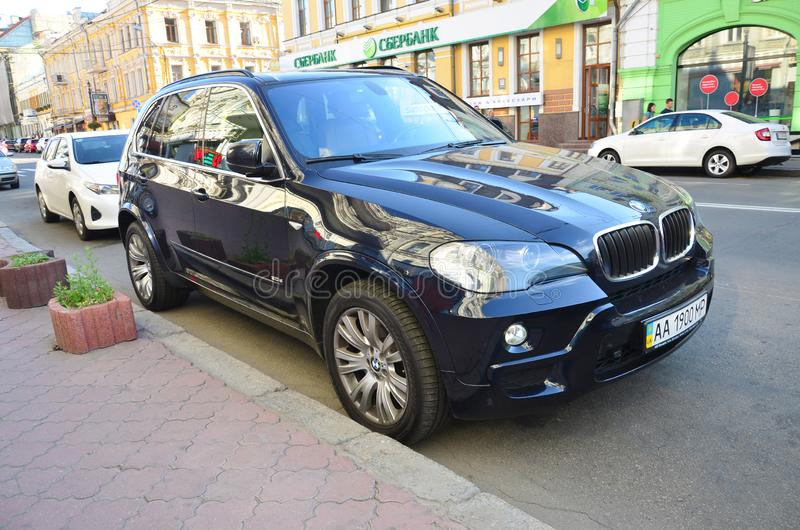 BMW X5 2011 black color car on Kyiv streets outdoors in evening. KYIV, UKRAINE - SEPTEMBER 19, 2017: BMW X5 2011 black. Bayerische Motoren Werke AG BMW is German stock photography