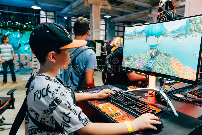 KYIV, UKRAINE - SEPTEMBER 22, 2018: Boy plays Fortnite. At Cougar stand at Comic Con Ukraine convention at Kyiv or Kiev royalty free stock photo
