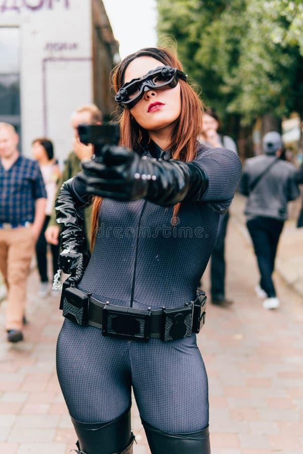 KYIV, UKRAINE - SEPTEMBER 23, 2018: Catwoman cosplayer posing stock photos