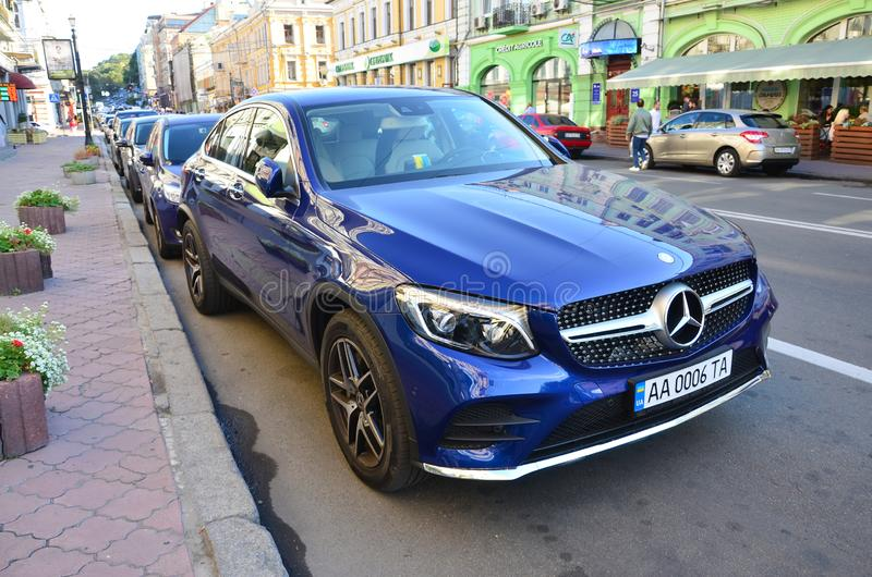 Mercedes-Benz CLS 500 4MATIC blue color on Kyiv streets in daytime royalty free stock image