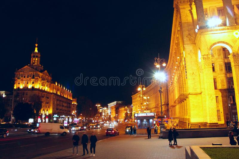 People walk on street of night Kyiv. Mass tourism in capital of Ukraine in evening stock images