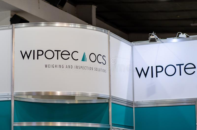 Kyiv, Ukraine - September 18, 2019:  Signboard WIPOTEC-OCS.  WIPOTEC-OCS is  innovative, reliable partner for high performance, stock photo