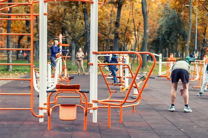 Kyiv,Ukraine - September 28th, 2019: People making sport exercises and training at public outdoor gym area at city park royalty free stock photos