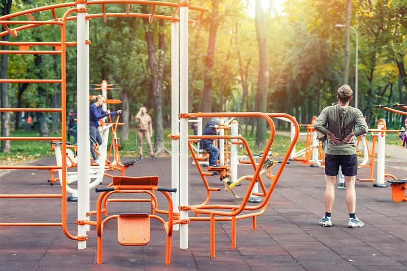 Kyiv,Ukraine - September 28th, 2019: People making sport exercises and training at public outdoor gym area at city park royalty free stock photo