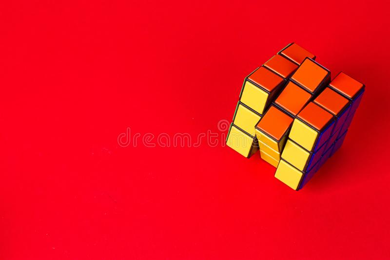 Kyiv, Ukraine - September 20th, 2017: Rubik`s Cube on the pink. Rubik`s cube invented by Hungarian architect Erno Rubik in 1974. Kyiv, Ukraine - September 20th stock photo