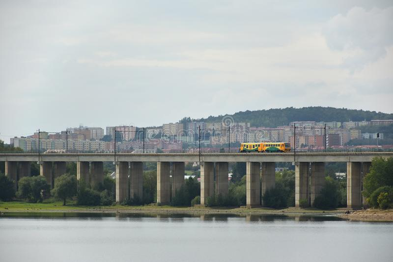 Kyjice, Czech republic - September 08, 2019: orange train of Ceske drahy train company on bridge over Ujezd dam stock photo
