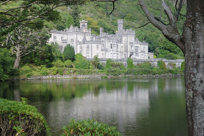 Kylemore abbey in landscape. Kylemore abbey reflexes in lake with beautiful nature around stock photos
