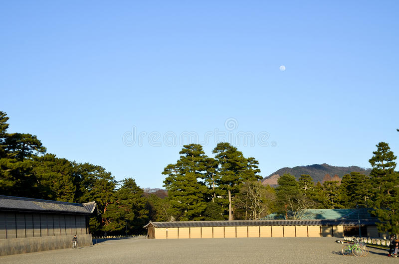 Kyoto Gyoen Garden, Mt. Daimonji and Moon in the Evening, Kyoto. Japan royalty free stock photo