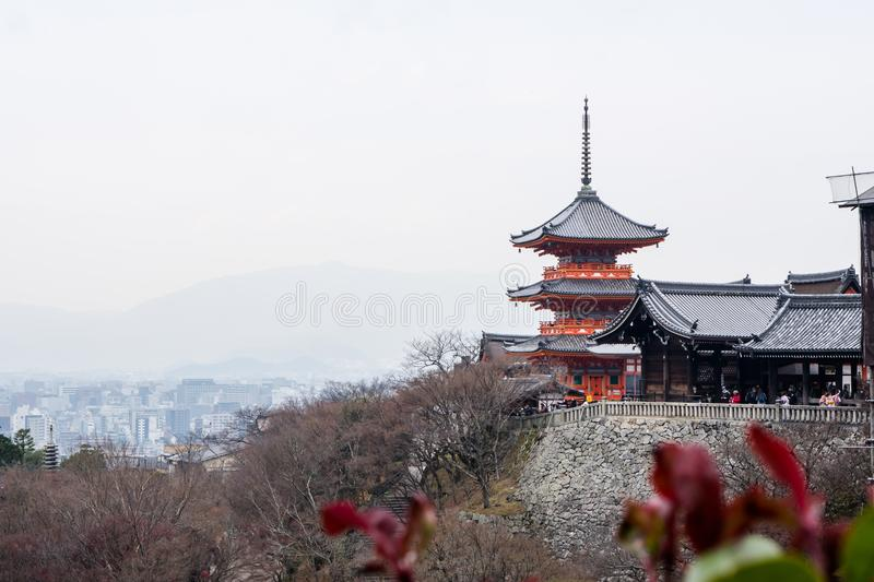 Kyoto, Japan –December 17, 2017: The Kiyomizu-dera Buddhist. Temple grounds and the skyline of Kyoto royalty free stock images