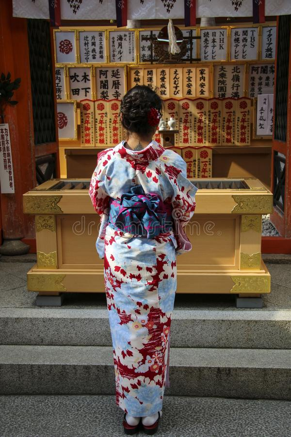 KYOTO, JAPAN- APRIL 03, 2019: Japanese girl in kimono dress in front of Jinja-Jishu shrine at the famous Kiyomizu-dera Buddhist. Temple in Kyoto, Japan stock images