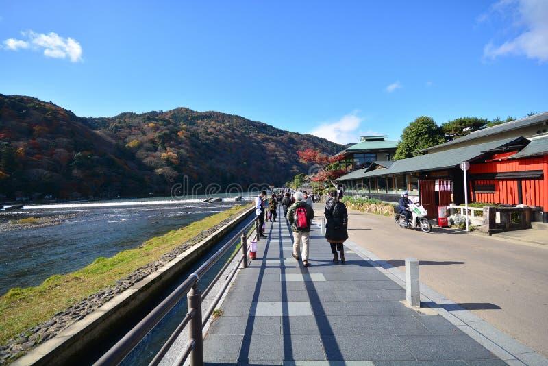 Kyoto, Japan - December 6, 2016: Arashiyama. Kyoto, Japan - December 6, 2016: Tourists walk on the bridges of Arashiyama. It is a pleasant, touristy district in stock images