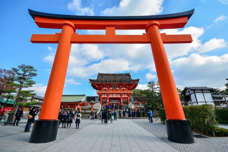Kyoto, Japan : December 7,2016 : Fushimi Inari Shrine. Kyoto, Japan : December 7,2016 : A giant torii gate in front of the Romon Gate at Fushimi Inari Shrine`s stock photo