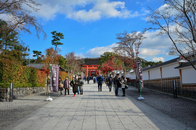 Kyoto, Japan : December 7,2016 : Fushimi Inari Shrine. Kyoto, Japan : December 7,2016 : A giant torii gate in front of the Romon Gate at Fushimi Inari Shrine`s royalty free stock photography
