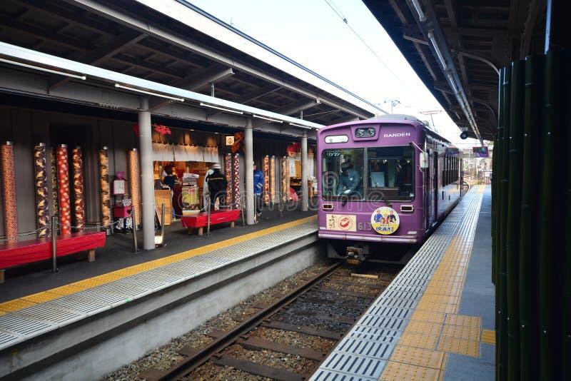 KYOTO, JAPAN - December 6, 2016 - Keifuku Randen Tram Line. Arriving at Arashiyama Randen Station royalty free stock photography