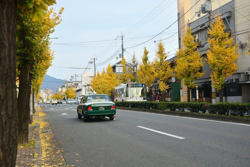 KYOTO JAPAN : December 5, 2016 - Kitano Tenmangu. KYOTO JAPAN : December 5, 2016 - The road at front of Kitano Tenmangu with yellow leaves of Ginkgo trees stock image