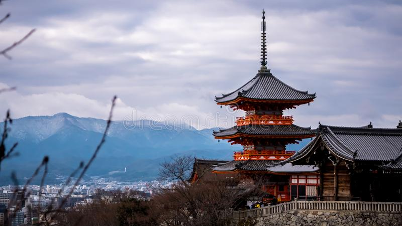 Winter view to Kiyomizu-dera triple tower. Kyoto, Japan - December 31, 2018 : Kiyomizu-dera triple tower with mountains as background, winter colors stock photography