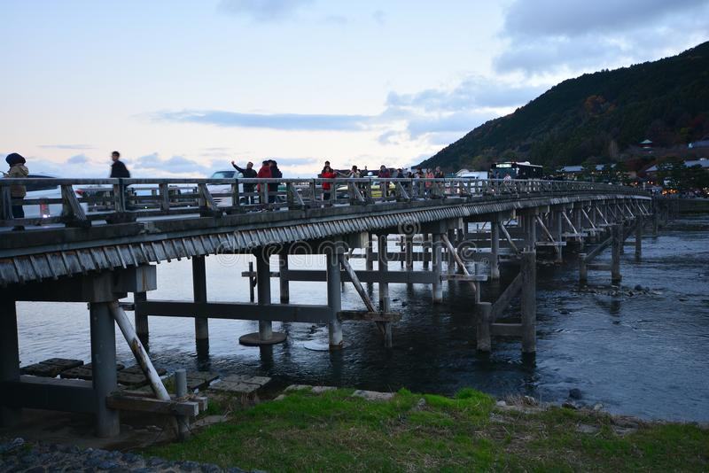 KYOTO, JAPAN - December 6, 2016 : Togetsukyo bridge, Arashiyama. KYOTO, JAPAN - December 6, 2016 : Togetsukyo bridge with the colourful forest background during royalty free stock image
