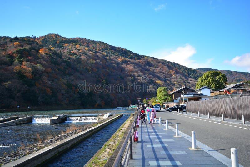Kyoto, Japan - December 6, 2016: Arashiyama. Kyoto, Japan - December 6, 2016: Tourists walk on the bridges of Arashiyama. It is a pleasant, touristy district in stock photos