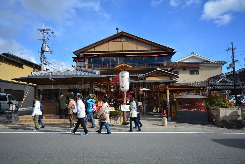 Kyoto, Japan - December 6, 2016: Arashiyama. Kyoto, Japan - December 6, 2016: Tourists walk on the road of Arashiyama. It is a pleasant, touristy district in the royalty free stock photos