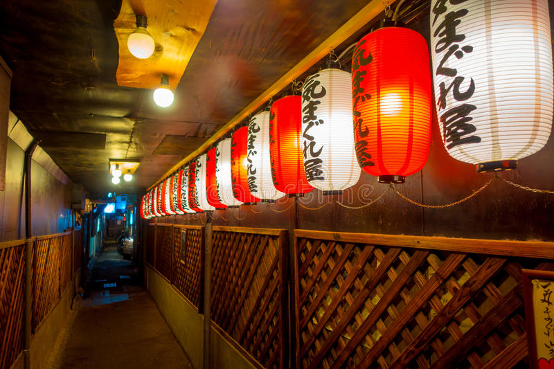 KYOTO, JAPAN - JULY 05, 2017: Beautiful paper lamps at night insdide of a building in Gion DIstrict, Kyoto. Japan royalty free stock photos
