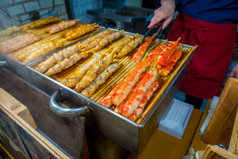 KYOTO, JAPAN - JULY 05, 2017: Grilled food in the Nishiki market, is an indoor shopping street located in the center of stock photography