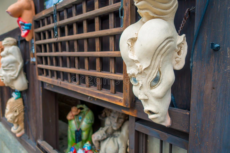 KYOTO, JAPAN - JULY 05, 2017: Halloween masks hanging ina wooden wall in outdoors, located in the center of Gion street. Of Kyoto, Japan royalty free stock photography