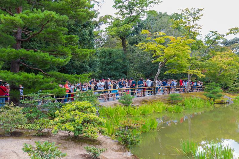 The Tourists visit Kinkaku-ji temple  It is a Zen Buddhist temple in Kyoto, Japan stock photos