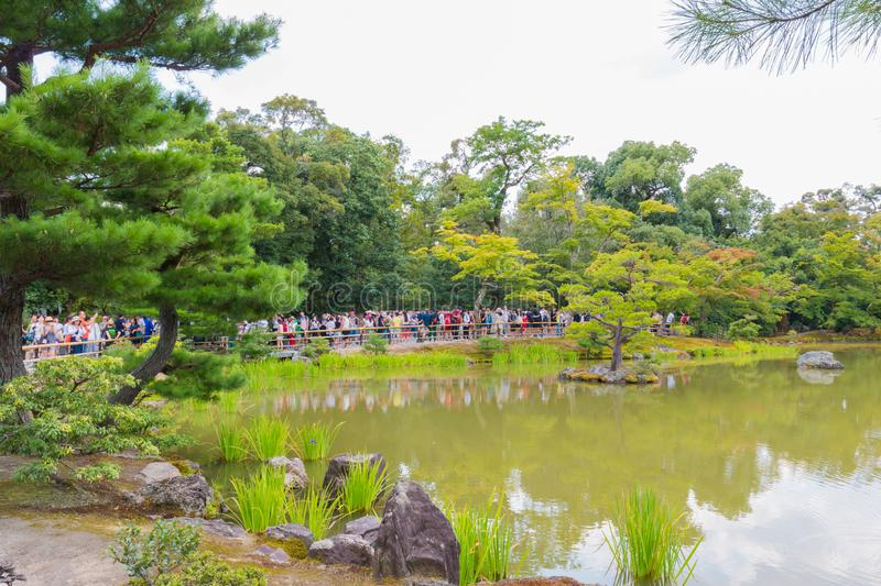 The Tourists visit Kinkaku-ji temple  It is a Zen Buddhist temple in Kyoto, Japan royalty free stock photography