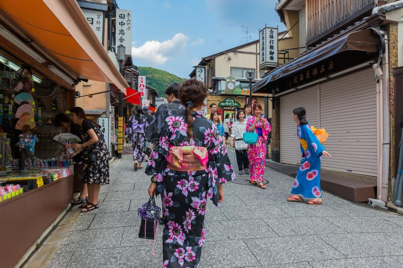 Tourists walk on a street around Kiyomizu-dera Temple kyoto, japan royalty free stock photography
