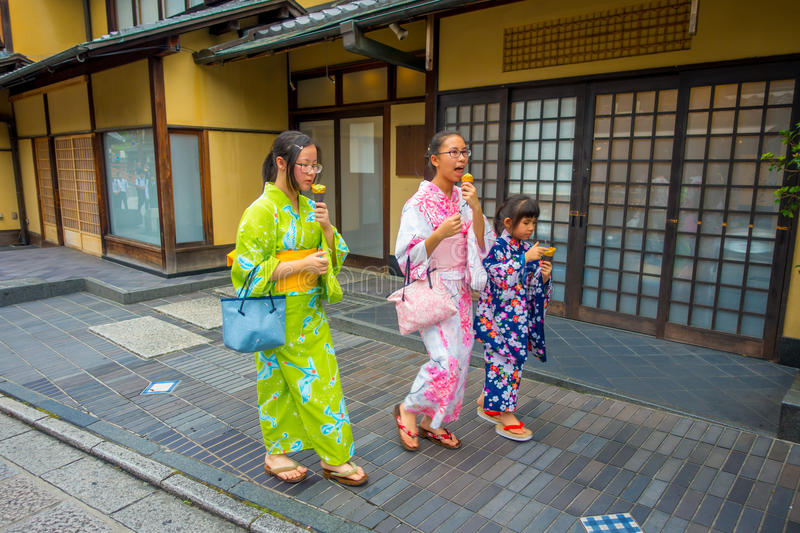 KYOTO, JAPAN - JULY 05, 2017: Unidentified people walking with a ice cream in the street of the center of Gion street of. Kyoto, Japan stock photography