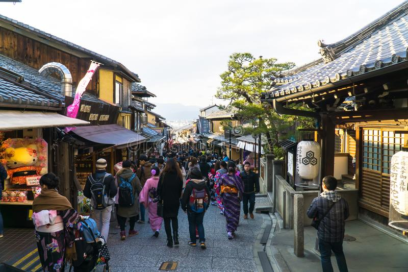 Kyoto, JAPAN-MAR 2, 2015 : Tourists walk around the tradition Japanese market along the Matsubara-dori street the way to royalty free stock image