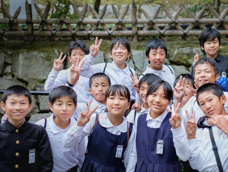 KYOTO,JAPAN - MARCH 24, 2015: Group of Japanese Elemantary school students in blue school uniform, looking at the photographer ma royalty free stock images