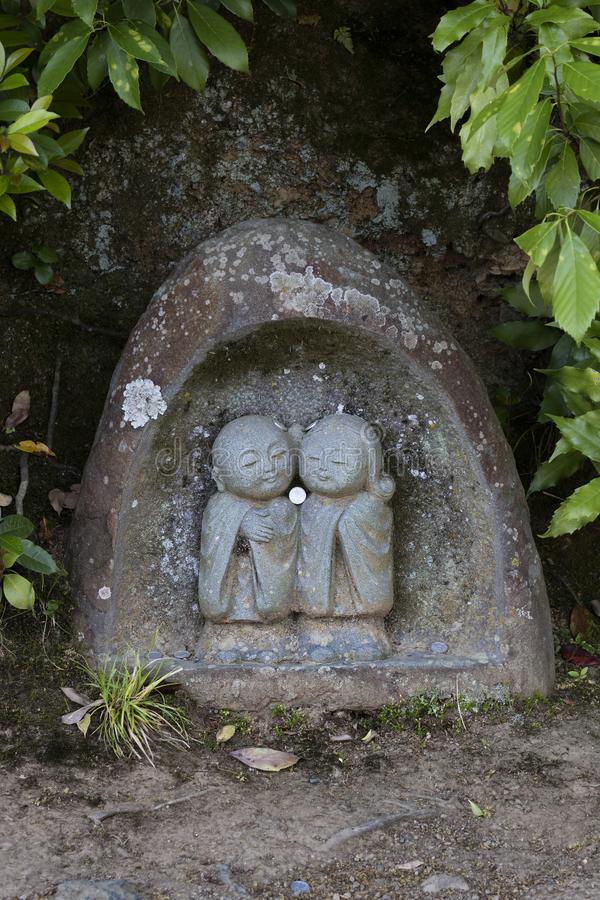 Kyoto - Japan, May 20, 2017: Traditional stone Jizo Bosatsu st royalty free stock photo