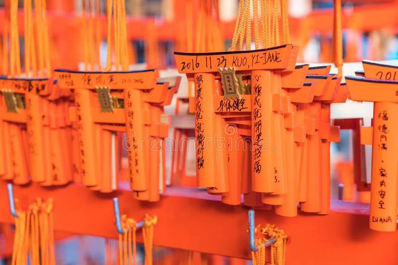 KYOTO, JAPAN - Nov 23, 2016 : Ema prayer tables with unique Torii gates boards at Fushimi Inari Taisha Temple in Kyoto. Pray for luck, wealth, happiness stock photos