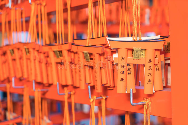 KYOTO, JAPAN - Nov 23, 2016 : Ema prayer tables with unique Torii gates boards at Fushimi Inari Taisha Temple in Kyoto. Pray for luck, wealth, happiness stock images